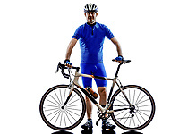 cyclist standing in silhouette on white background