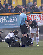 Christian Nade is treated for a head knock by Dundee physio Karen Gibson after opening the scoring for Dundee - Alloa Athletic v Dundee, SPFL Championship at Recreation Park, Alloa<br /> <br />  - &copy; David Young - www.davidyoungphoto.co.uk - email: davidyoungphoto@gmail.com