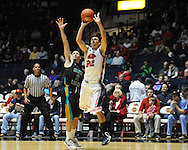 "Mississippi's Marshall Henderson (22) shoots against Coastal Carolina's Anthony Raffa (2) at the C.M. ""Tad"" Smith Coliseum in Oxford, Miss. on Tuesday, November 13, 2012. (AP Photo/Oxford Eagle, Bruce Newman)"