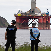Greenpeace activists board a BP oil rig in Cromarty Firth to stop it from further oil drilling at sea, June 10th 2019, Cromarty, Scotland, United Kingdom. The oil rig 'Paul B. Loyd, Jnr', owned by Transocean, was due to head to BP's Vorlich field, 150 miles (241km) east of Aberdeen to drill for oil for BP. Police monitoring the the occupied oil rig. The occupation by Greenpeace activists subsequently delayed the departure for 5 days and 14 activists were arrested in the process. Greenpeace says that in an age of climate emergency BP should not be drilling for new oil but look for non-fossil fuel means of energy.