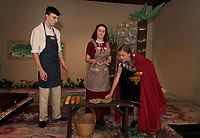 "Little Red (Kathryn Osburn) helps herself to the Baker and his wife's (Chris Renaud and Chelsea Sasserson) breads during dressing rehearsal for SKYT's musical ""Into The Woods"" at the Gilford Methodist Church.  (Karen Bobotas/for the Laconia Daily Sun)(Karen Bobotas/for the Laconia Daily Sun)"