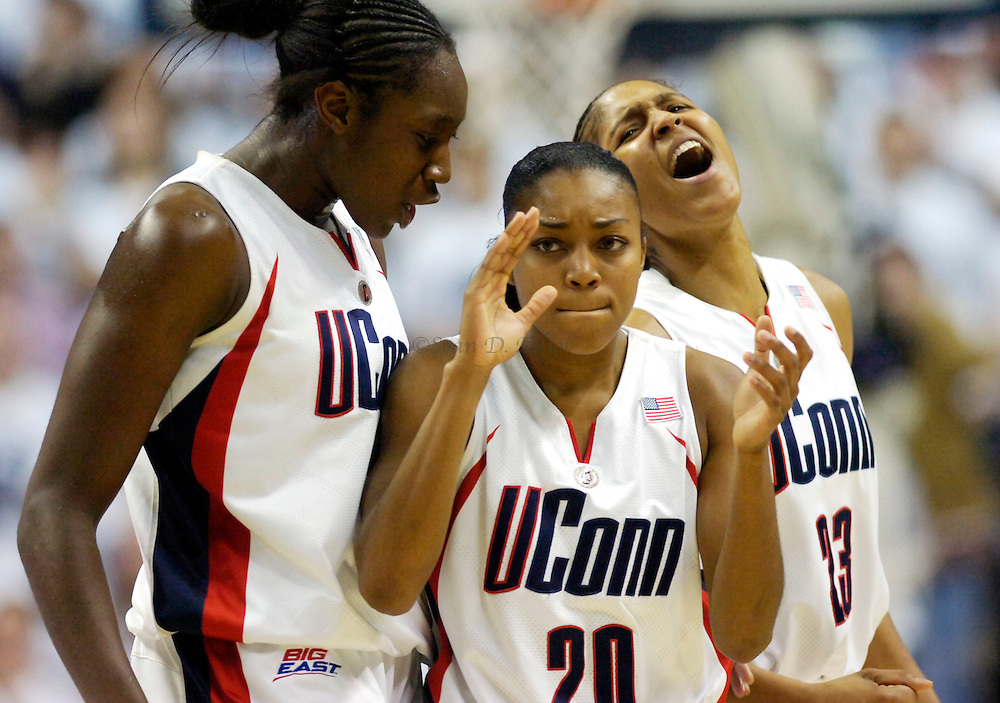 UConn's Tina Chalres, Renee Montgomery and Maya Moore celebrate as time ticks down on the huskies 82-71 win over North Carolina in women's basketball action Mon. Nov. 21, 2007 at Gampel Pavilion in Storrs.  (Sean D. Elliot/photo)
