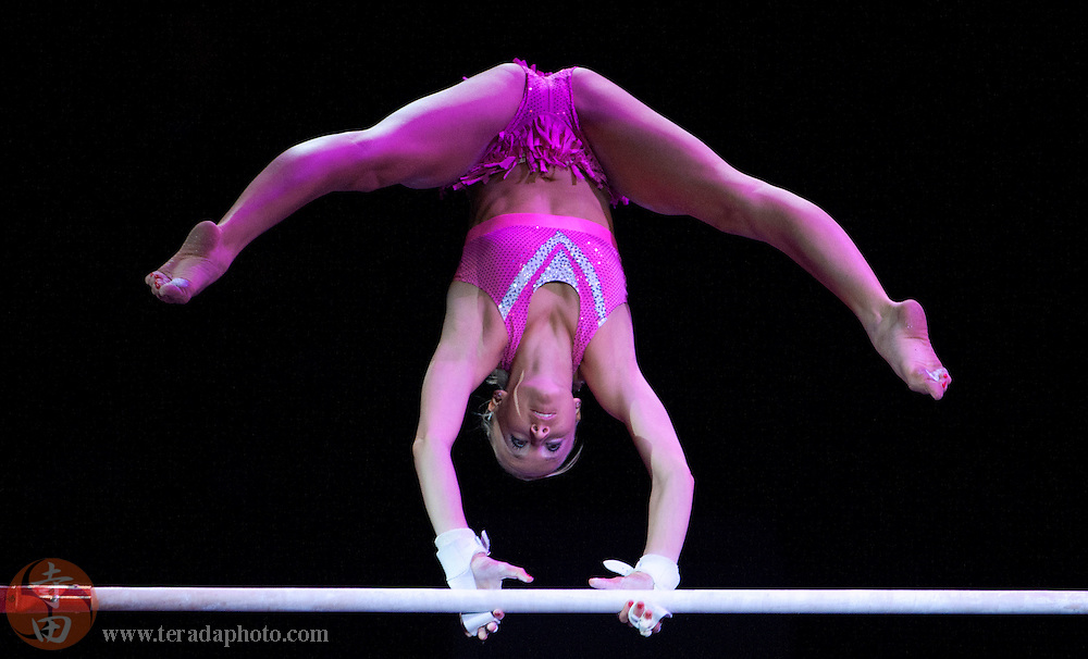 Sep 21, 2008; San Jose, CA, USA; Nastia Liukin performs on the uneven bars during the 2008 Tour of Gymnastics Superstars post-Beijing Olympic tour at HP Pavilion in San Jose, CA. Mandatory Credit: Kyle Terada-Terada Photo