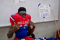 Folsom Bulldogs Joe Ngata (10), puts on his shoulder pads before the game as the Folsom High School Bulldogs varsity football team hosts the Central High School Grizzlies in the CIF NorCal Division I-AA title game, Friday Dec 8, 2017. The winner of this game will face the CIF SoCal winner in the State Championship game at Sacramento State, Friday Dec 15th.<br /> photo by Brian Baer