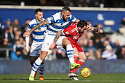 Queens Park Rangers defender Joel Lynch tackles Nottingham Forest forward Lee Tomlin during the EFL Sky Bet Championship match between Queens Park Rangers and Nottingham Forest at the Loftus Road Stadium, London, England on 24 February 2018. Picture by Toyin Oshodi.