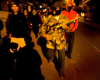 Members of a citizen security patrol group, stand guard armed with weapons and machetes and raidos patrol the street at night in Barcenas Wednesday Sept. 5, 2007 in Guatemala City Guatemala. The vigilanties were forced to take to the streets after increased threats of murder and extortion along with a gun battle with automatic weapons where they killed a expected gang member on Sunday. Crime has become a serious issue in the upcoming elections that are to take place on Sept. 9 2007.  ....