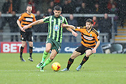 George Francomb of AFC Wimbledon and Luke Gambin of Barnet FC tussle during the Sky Bet League 2 match between Barnet and AFC Wimbledon at Underhill Stadium, London, England on 20 February 2016. Photo by Stuart Butcher.