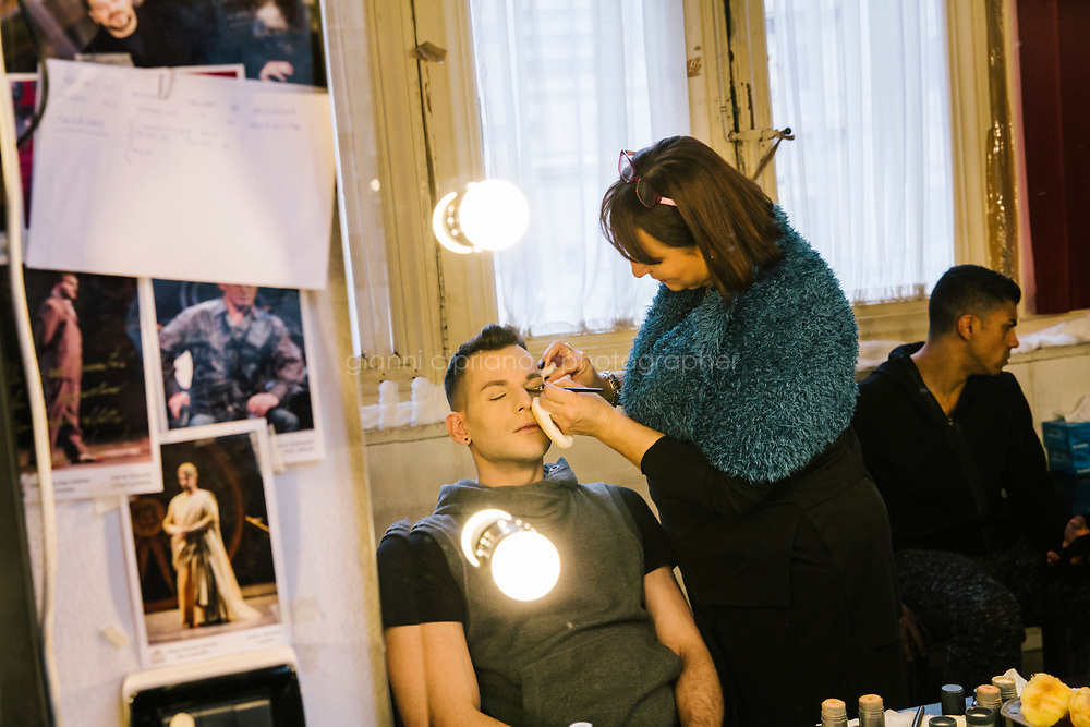 PALERMO, ITALY - 18 FEBRUARY 2018: Dancer Marcello Carini, who interprets the role of Gamache in &quot;Don Quixote&quot;, has his make-up done by make-up artist Maria Lucia Lucchese shortly before the dress rehearsal at the Teatro Massimo in Palermo, Italy, on February 18th 2018.<br /> <br /> The Teatro Massimo Vittorio Emanuele is an opera house and opera company located  in Palermo, Sicily. It was dedicated to King Victor Emanuel II. It is the biggest in Italy, and one of the largest of Europe (the third after the Op&eacute;ra National de Paris and the K. K. Hof-Opernhaus in Vienna), renowned for its perfect acoustics. It was inaugurated in 1897.