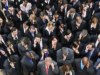 Large group of business people using mobile phones elevated view
