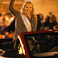 Adam Robison | BUY AT PHOTOS.DJOURNAL.COM<br /> Helen McDougald, International Jr. Miss Mississippi waves to the crowd as she rides along the parade route in the Tupelo Christmas Parade Friday night in Tupelo.