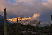 Winter snow that covered Cathedral Rock earlier in the day is seen at sunset from Sabino Canyon, Sonoran Desert, Tucson, Arizona, USA. (PHOTO: Norma Jean Gargasz) (NOTE:  This rock was identified by park personnel for me.  The ID appears to be correct following a Google search.  Please doublecheck if need be.)
