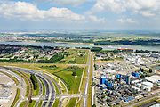Nederland, Zuid-Holland, Rotterdam, 10-06-2015; Rozenburg, Blankenburgtrace met Botlekweg gezien naar Maassluis. De groenstrook tussen Rozenburg en het havengebied is gereserveerd voor een mogelijke tunnelverbinding tussen A15 (onder in beeld) en de A20, de Blankenburgverbinding.<br /> The open space between the buildings and the industry is reserved for a future tunnel entrance.<br /> luchtfoto (toeslag op standard tarieven);<br /> aerial photo (additional fee required);<br /> copyright foto/photo Siebe Swart