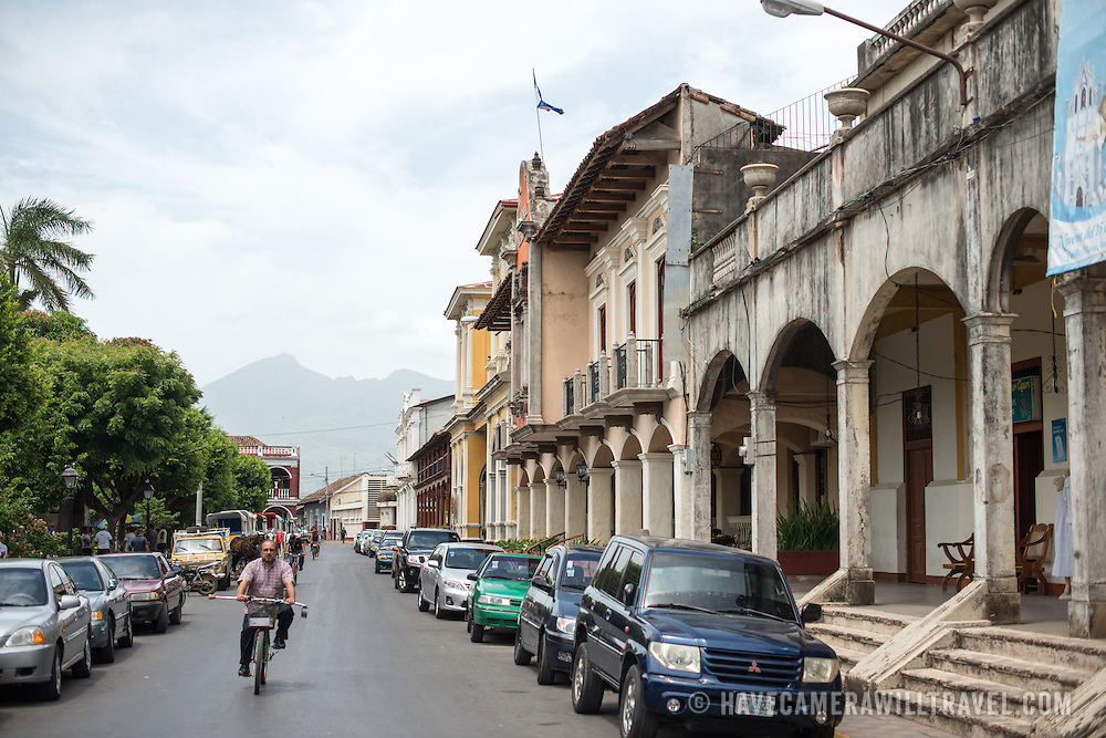 A street alongside Parque Central, lined with Spanish colonial buildings. Parque Central is the main square and the historic heart of Granada, Nicaragua.