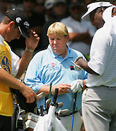 Golfer John Daly (C) is seen with Vijay Singh (R) and an unidentified caddie (L) during the first round of the 2005 PGA Championship at Baltusrol Golf Club in Springfield, New Jersey, Thursday 11 August 2005.