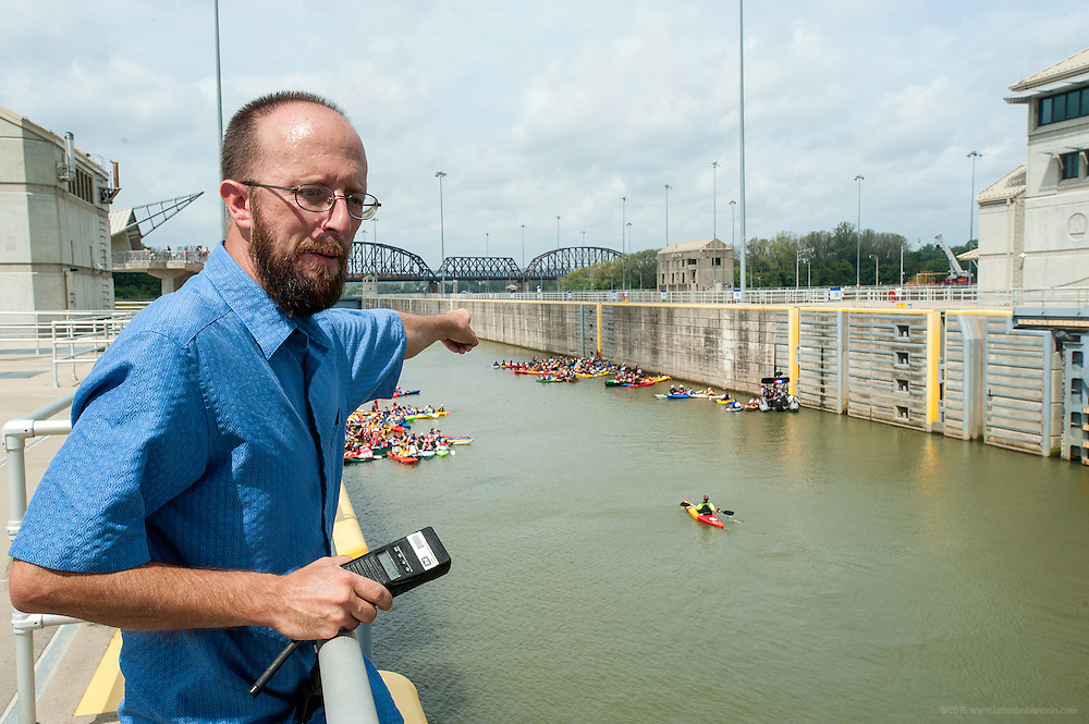 Lockmaster Mike Seng directs paddlers waiting to pass through the McAlpine Locks to stay together before the water falls as they make their way to New Albany as part of the Mayor's Hike Bike & Paddle event at Waterfront Park. September 1, 2014