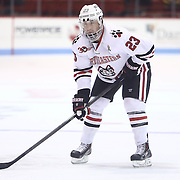 Colton Saucerman #23 of the Northeastern Huskies on the ice during the game at Matthews Arena on January 18, 2014 in Boston, Massachusetts. (Photo by Elan Kawesch)