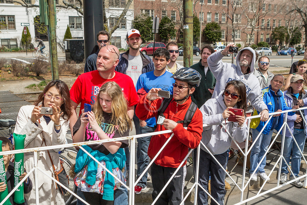 2014 Boston Marathon: spectators line race course to cheer passing runners