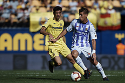 September 30, 2018 - Villarreal, Castellon, Spain - Ruben Alcaraz Jimenez (R) of Real Valladolid competes for the ball with Gerard Moreno of Villarreal CF during the La Liga match between Villarreal CF and Real Valladolid at Estadio de la Ceramica on September 30, 2018 in Vila-real, Spain  (Credit Image: © David Aliaga/NurPhoto/ZUMA Press)