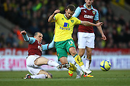 Picture by Paul Chesterton/Focus Images Ltd.  07904 640267.07/01/12.David Fox of Norwich and Dean Marney of Burnley in action during the FA Cup third round match at Carrow Road Stadium, Norwich.
