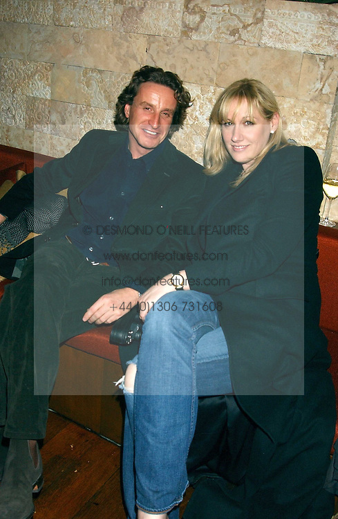TIM ATTIAS and AMY SACCO owner of the famous Bungalow 8 club in New York at a party hosted by Daniella Helayel of fashion label ISSA held at Taman Gang, 141 Park Lane, London on 15th February 2006.<br /><br />NON EXCLUSIVE - WORLD RIGHTS