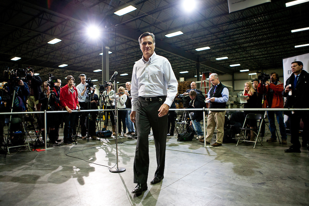 Republican presidential candidate Mitt Romney walks away from the microphone after a media availability on Friday, December 9, 2011 in Cedar Rapids, IA.