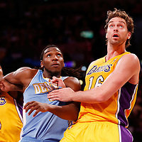 06 October 2013: Denver Nuggets small forward Kenneth Faried (35) vies for the rebound with Los Angeles Lakers power forward Pau Gasol (16) and Los Angeles Lakers shooting guard Nick Young (0) during the Denver Nuggets 97-88 victory over the Los Angeles Lakers at the Staples Center, Los Angeles, California, USA.