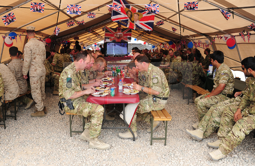 Camp Bastion, Afghanistan  29/04/2011. The Royal Wedding of HRH Prince William to Kate Middleton. Soldiers from 3 Mercian Regiment watch the wedding today in Camp Bastion, Afghanistan.  The soldiers made the most of the event by organising a BBQ and a well deserved day off.  Photo credit should read Alison Baskerville/LNP. Please see special instructions. © under license to London News Pictures