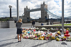 June 7, 2017 - London, United Kingdom - Flowers are pictured outside Citu Hall, in London on June 6, 2017, placed in memory of the victims of the June 3 terror attacks. The number of the victims has risen to 8. Police identified all the three London attackers as Khuram Butt, Rachid Redouane and Youssef Zaghba, after Britain's third terror assault in less than three months, as Prime Minister Theresa May came under mounting pressure over security just days ahead of elections. (Credit Image: © Alberto Pezzali/NurPhoto via ZUMA Press)