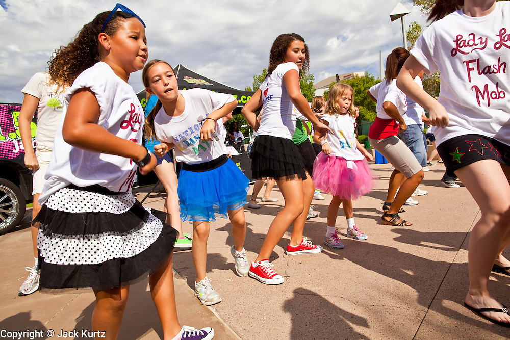 "30 JULY 2011 - PHOENIX, AZ:   Girls dance in a flash mob in downtown Phoenix, AZ, Saturday. About 200 people showed up at Heritage Square in downtown Phoenix Saturday morning for a flash mob coordinated by the Arizona Science Center. The mob danced to several hip-hop songs before disbanding. The event was a part of National Dance Day Activities and the First Lady's ""Let's Move!"" physical fitness campaign.      PHOTO BY JACK KURTZ"