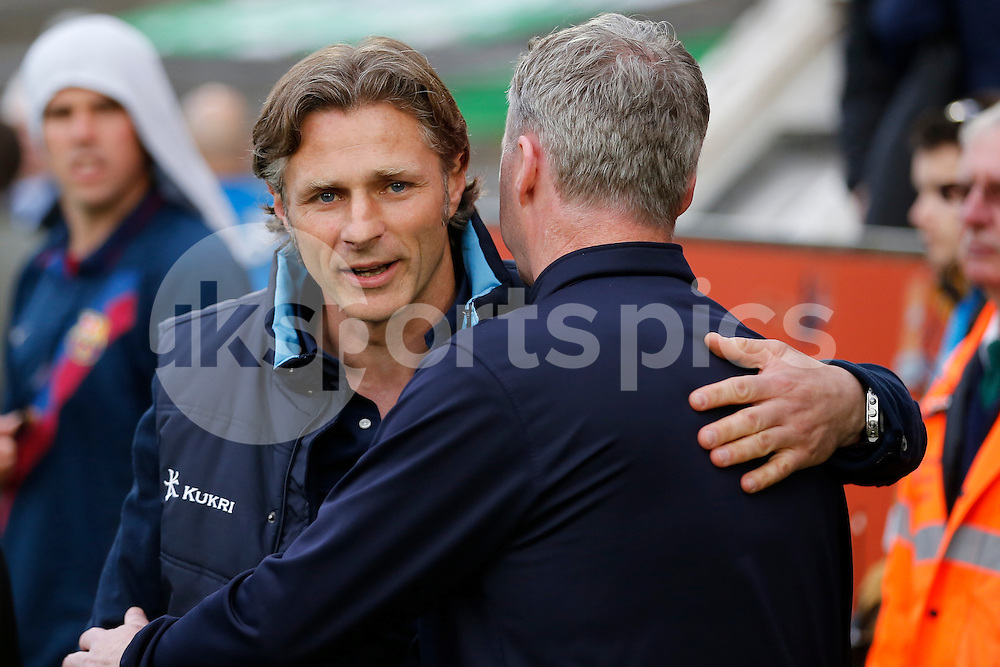 Wycombe Wanderers manager Gareth Ainsworth greets Plymouth Argyle manager John Sheridan ahead of the Sky Bet League 2 Play Off 1st Leg match between Plymouth Argyle and Wycombe Wanderers at Home Park, Plymouth, England on 9 May 2015. Photo by Mark Hawkins.