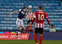 Football - 2019 / 2020 Emirates FA Cup - Fourth Round: Millwall vs. Sheffield United<br /> <br /> Jack O'Connell (Sheffield United) heads clear under pressure from Matt Smith (Millwall FC) at The Den.<br /> <br /> COLORSPORT/DANIEL BEARHAM