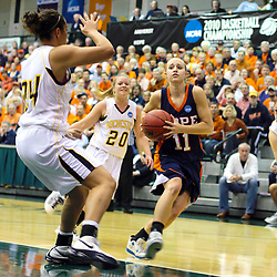 19 March 2010:Miranda DeKuiper drives towards the goal which is being protected by Madeline Korber. The Flying Dutch of Hope College defeat the Yellowjackets of the University of Rochester in the semi-final round of the Division 3 Women's Basketball Championship by a score of 86-75 at the Shirk Center at Illinois Wesleyan in Bloomington Illinois.