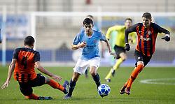 Manchester City U19's Nabil Touaizi battles for the ball with Shakhtar Donetsk's Roman Yakuba
