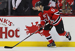 Jan 31, 2013; Newark, NJ, USA; New Jersey Devils defenseman Adam Larsson (5) skates with a puck during the warmups for their game against the New York Islanders at the Prudential Center.