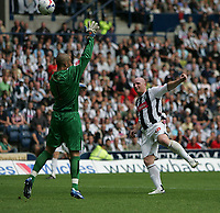 Photo: Lee Earle.<br /> West Bromwich Albion v Hull City. Coca Cola Championship. 05/08/2006. Albion's John Hartson (R) beats Hull keeper Boaz Myhill to score the opening goal.