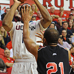Rutgers Scarlet Knights forward/center Austin Johnson (21) gets in Connecticut Huskies center Andre Drummond's (12) face as he shoots during Rutgers' 67-60 upset victory over #8 UConn in NCAA Big East Basketball action at the Louis Brown Athletic Center in Piscataway, N.J. on Jan 7, 2012.