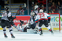 KELOWNA, BC - JANUARY 4:  Matthew Wedman #20 of the Kelowna Rockets falls to the ice after taking a shot which is saved by David Tendeck #30 of the Vancouver Giants at Prospera Place on January 4, 2020 in Kelowna, Canada. (Photo by Marissa Baecker/Shoot the Breeze)