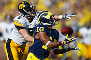 November 17, 2012; Ann Arbor, MI, USA; Michigan Wolverines wide receiver Jeremy Gallon (10) makes a reception as Iowa Hawkeyes defensive back Tanner Miller (5) defends in the second quarter at Michigan Stadium. Mandatory Credit: Rick Osentoski-US PRESSWIRE