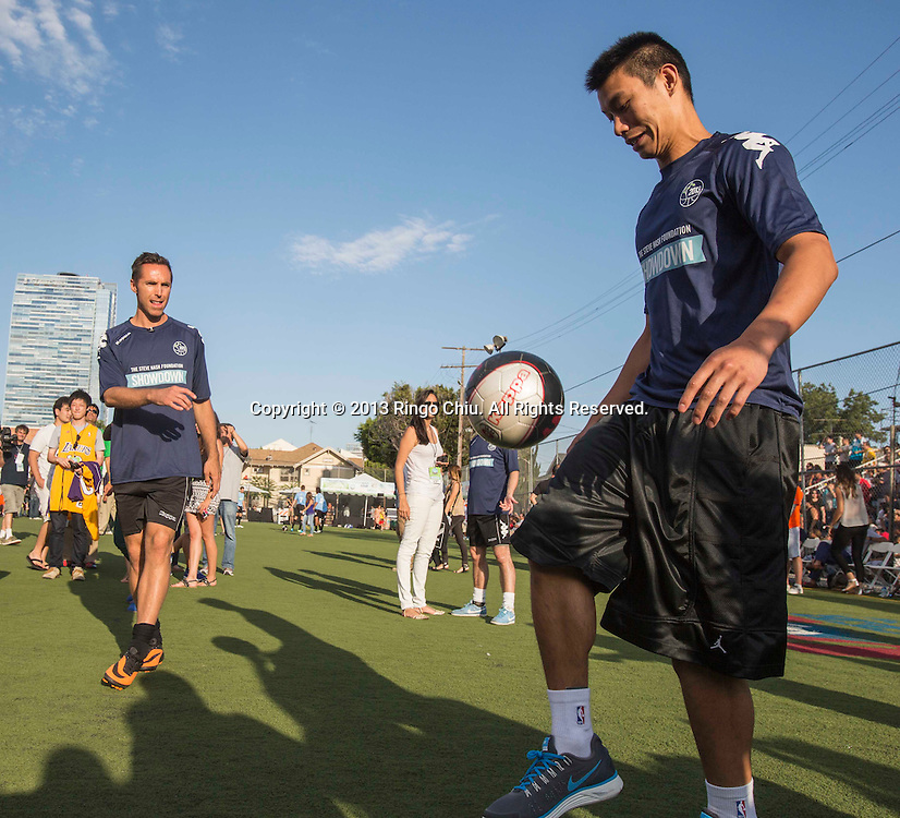 Basketball Players Steve Nash looks on as Jeremy Lin warms up with a soccer ball as he attends Steve Nash Foundation Showdown, a competitive pick-up-style charity soccer match, at the Salvation Army Red Shield Community Center on July 14, 2013 in Los Angeles California. (Photo by Ringo Chiu/PHOTOFORMULA.com)