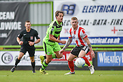 Forest Green Rovers Midfielder, Darren Carter (12) gets past Lincoln City Midfielder, Alan Power (8) during the Vanarama National League match between Forest Green Rovers and Lincoln City at the New Lawn, Forest Green, United Kingdom on 19 November 2016. Photo by Adam Rivers.