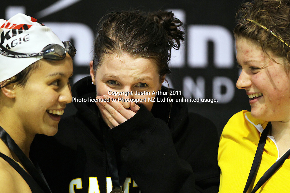 Samantha Lee shears a joke on the podium.2011 New Zealand Short Course Championships, Day 3, Wellington Aquatics Centre, Kilbirnie, Wellington, Monday 8 August 2011. Photo: Justin Arthur / photosport.co.nz