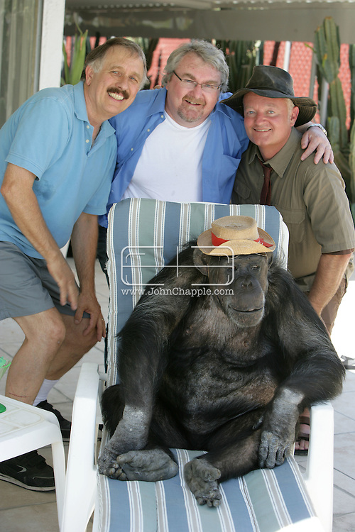 EXCLUSIVE 24th June 2008, Palm Springs, California.  Cheeta's owner Dan Westfall (left) with record exec John Trickett  (center) and filmmaker and campaign manager Matthew Devlen (right), of the &quot;Go Cheeta&quot; campaign, who are trying to get Cheeta the 76-year-old Chimp a star on the Hollywood Walk of Fame. Cheeta was the star of many Hollywood Tarzan films of the 1930s and 1940s,  PHOTO &copy; JOHN CHAPPLE / www.johnchapple.com<br /> tel: +1-310-570-9100