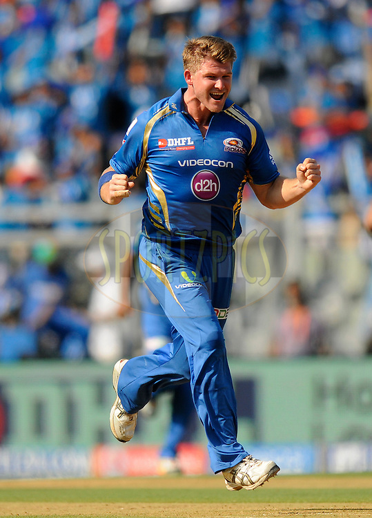 Corey Anderson of the Mumbai Indians celebrates the wicket of Cheteshwar Pujara of the Kings X1 Punjab during match 22 of the Pepsi Indian Premier League Season 2014 between the Mumbai Indians and the Kings XI Punjab held at the Wankhede Cricket Stadium, Mumbai, India on the 3rd May  2014<br /> <br /> Photo by Pal Pillai / IPL / SPORTZPICS<br /> <br /> <br /> <br /> Image use subject to terms and conditions which can be found here:  http://sportzpics.photoshelter.com/gallery/Pepsi-IPL-Image-terms-and-conditions/G00004VW1IVJ.gB0/C0000TScjhBM6ikg