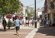 People shopping in pedestrianised High Street area, Poole, Dorset, England, UK