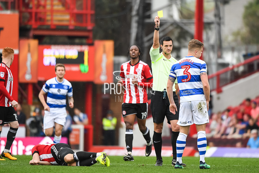 Queens Park Rangers Defender Jake Bidwell (3) gets a yellow card for his challenge on Brentford Forward Neal Maupay (9) during the EFL Sky Bet Championship match between Brentford and Queens Park Rangers at Griffin Park, London, England on 21 April 2018. Picture by Stephen Wright.