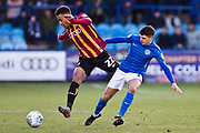 \Bradford City defender Kelvin Mellor challenged by Macclesfield Town midfielder Connor Kirby during the EFL Sky Bet League 2 match between Macclesfield Town and Bradford City at Moss Rose, Macclesfield, United Kingdom on 30 November 2019.