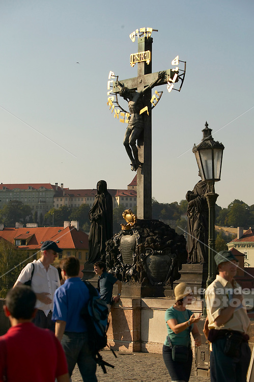 Czeck Republic - Prague, Crucifix and statuary line the Charles Bridge
