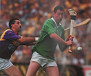 Limerick's Frankie Carroll gets his shot in despite the attention of Wexford's Martin Storey in the 1996 All-Ireland Final.