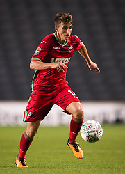 "Swansea's Tom Carroll during the Carabao Cup, Second Round match at Stadium MK, Milton Keynes. PRESS ASSOCIATION Photo. Picture date: Tuesday August 22, 2017. See PA story SOCCER MK Dons. Photo credit should read: Scott Heavey/PA Wire. RESTRICTIONS: EDITORIAL USE ONLY No use with unauthorised audio, video, data, fixture lists, club/league logos or ""live"" services. Online in-match use limited to 75 images, no video emulation. No use in betting, games or single club/league/player publications."