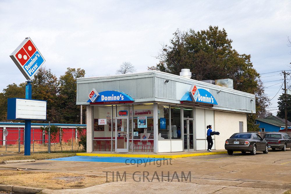 Woman delivering fast food from Domino's Pizza in Clarksdale, birthplace of the Blues, Mississippi USA